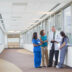 Doctor and nurses talking in hospital hallway
